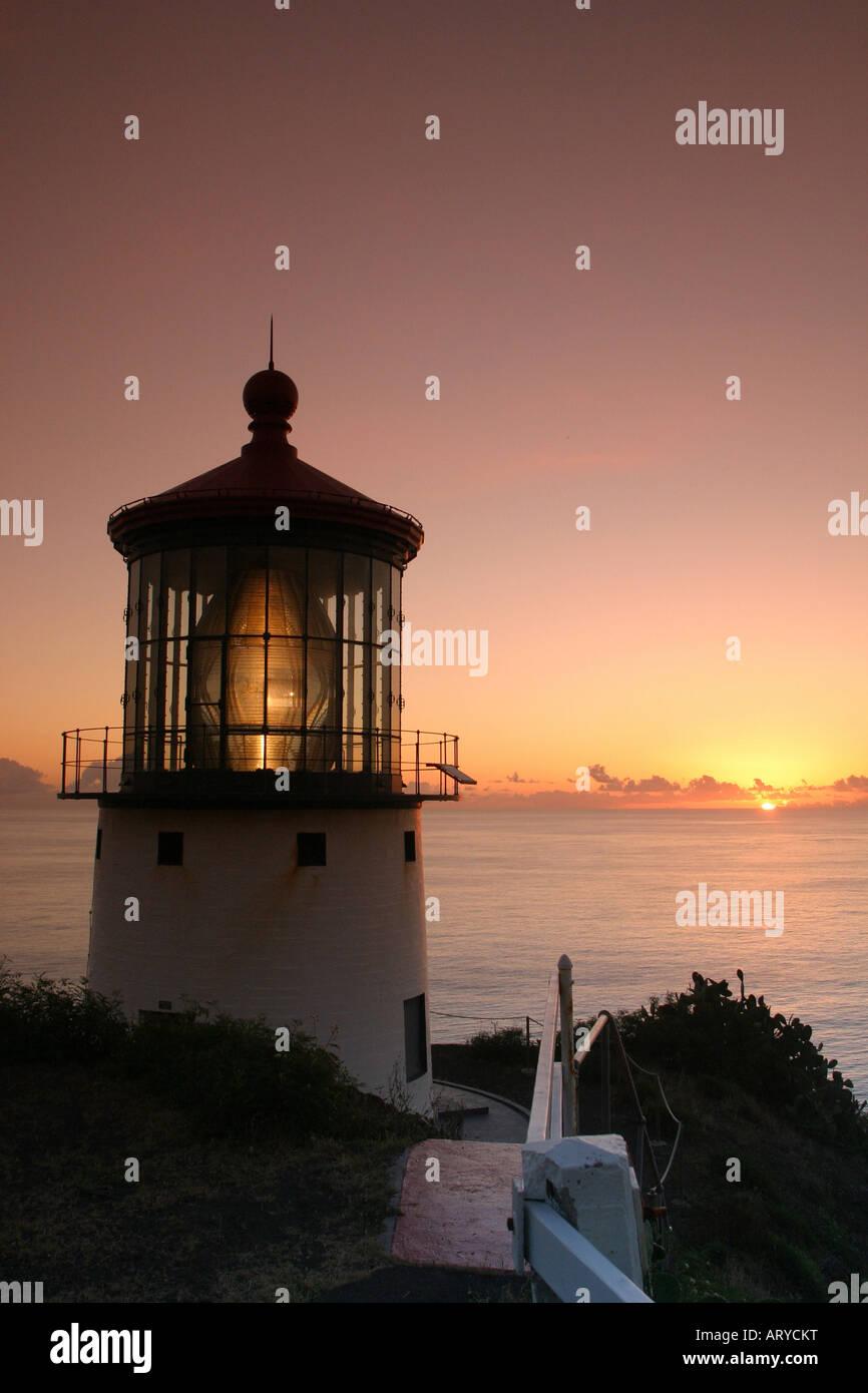 Makapuu pt. lighthouse at sunrise. Located along the southeast coast of oahu. Stock Photo