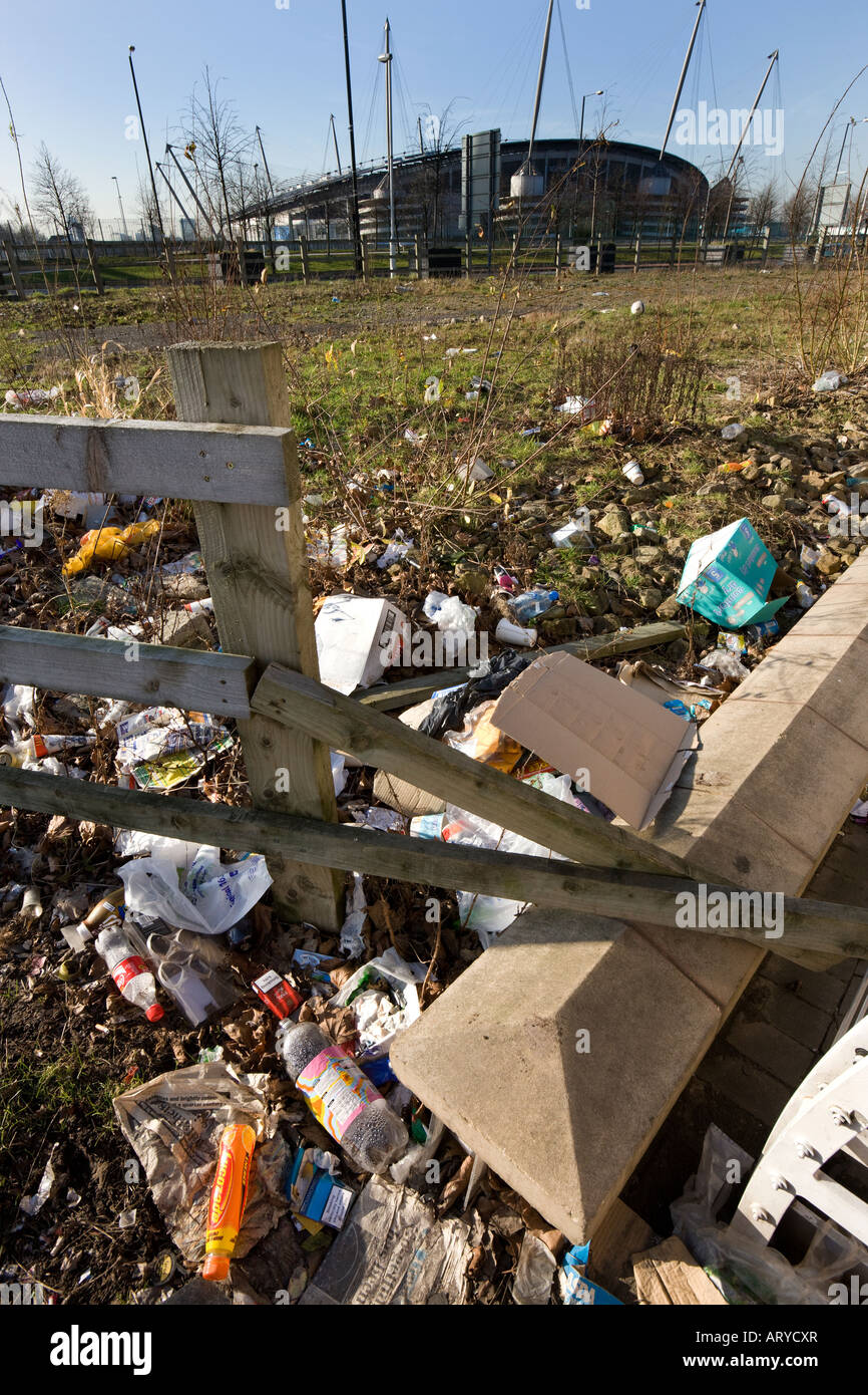 Litter on waste ground near The City of Manchester Stadium in Manchester in the United Kingdom - Stock Image