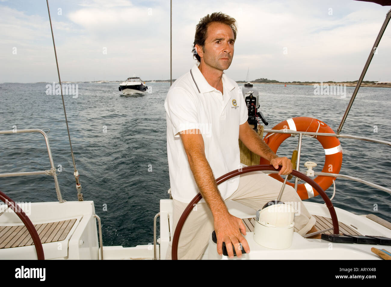 Man posing as a sea captain - Stock Image