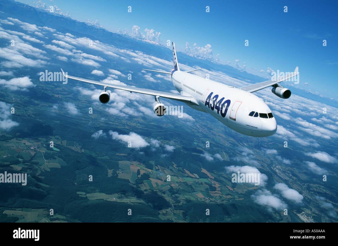 passenger aircraft in flight Airbus A340 passenger aircraft - Stock Image