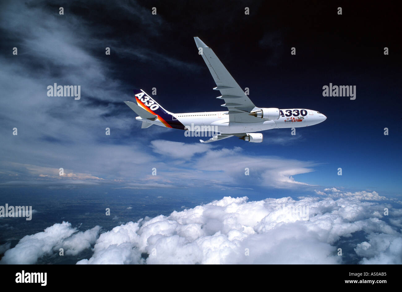 passenger aircraft in flight Airbus A330 flying above cloud - Stock Image