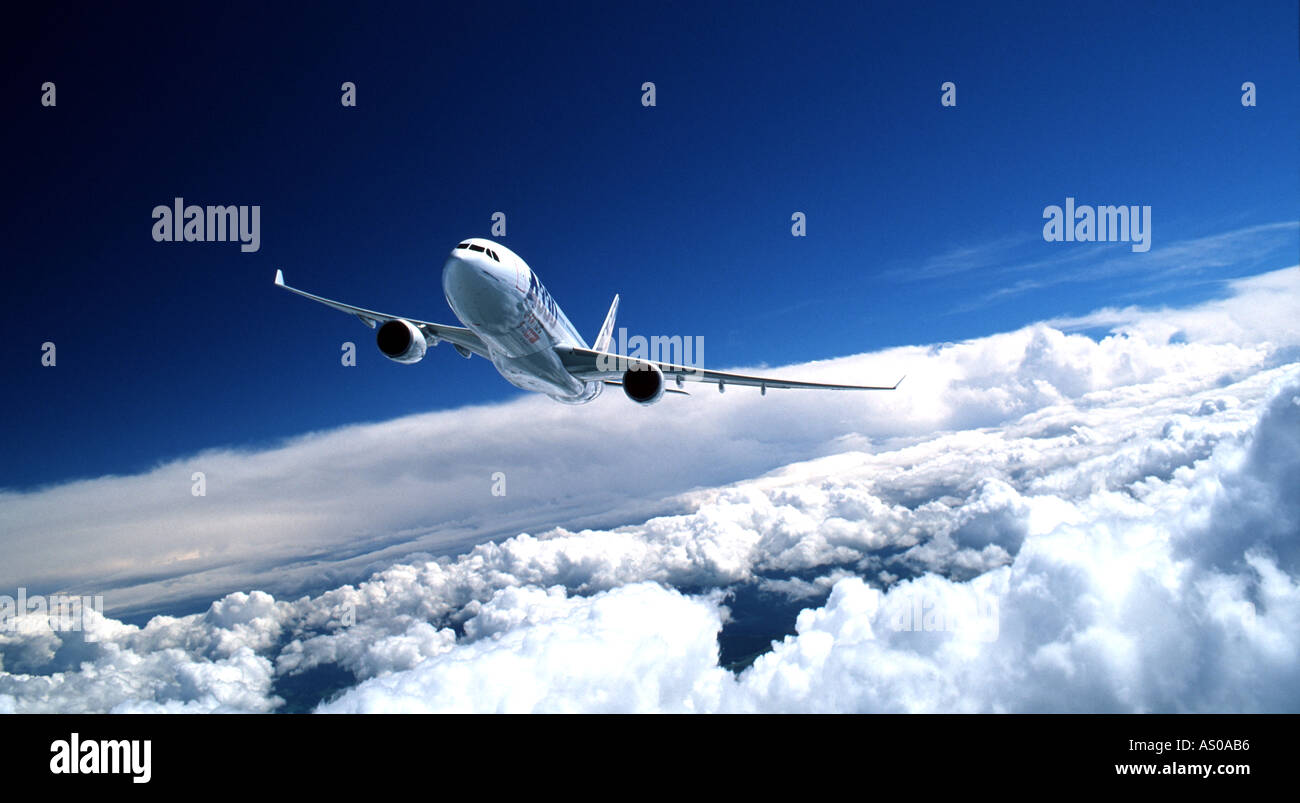 passenger aircraft in flight Airbus 330 aircraft flying above the clouds - Stock Image