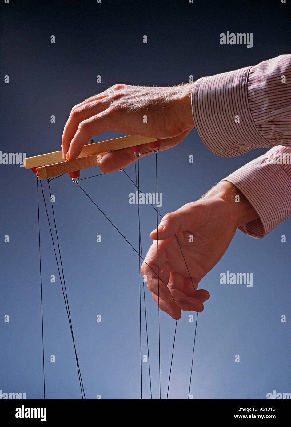 Controlling and manipulating Hands of corporate puppeteer - Stock Image