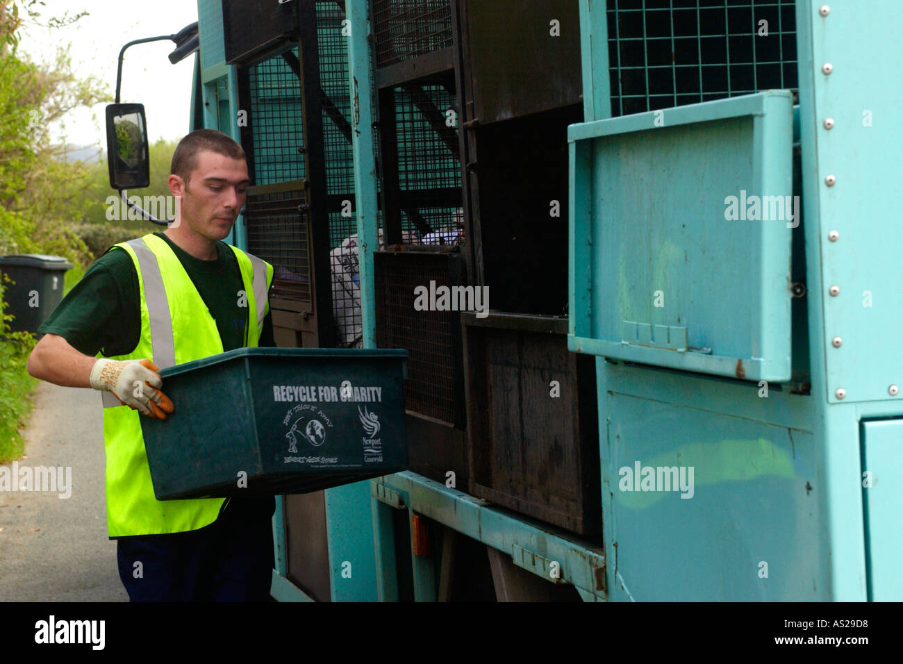 Boxes containing recyclable domestic rubbish collected by Wastesavers community recycling group from households Stock Photo