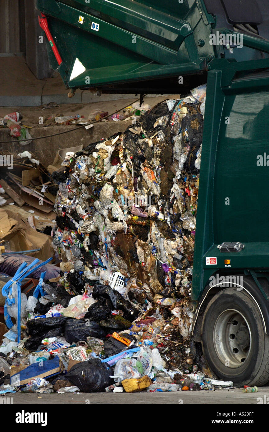 Domestic rubbish being unloaded from refuse truck at a landfill site in Newport South Wales UK - Stock Image