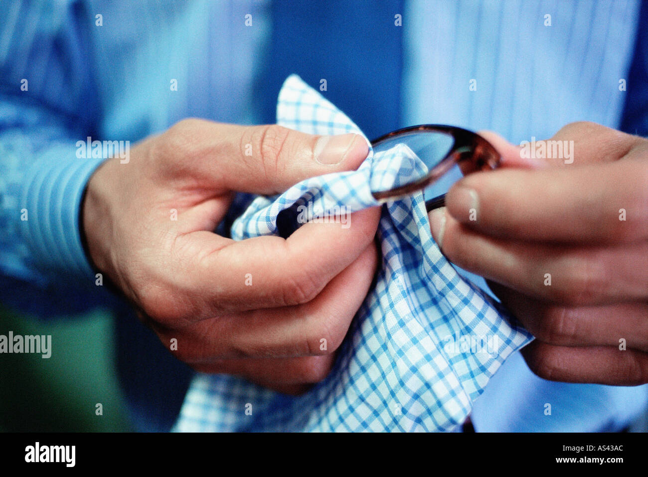 Man cleaning spectacle lenses - Stock Image