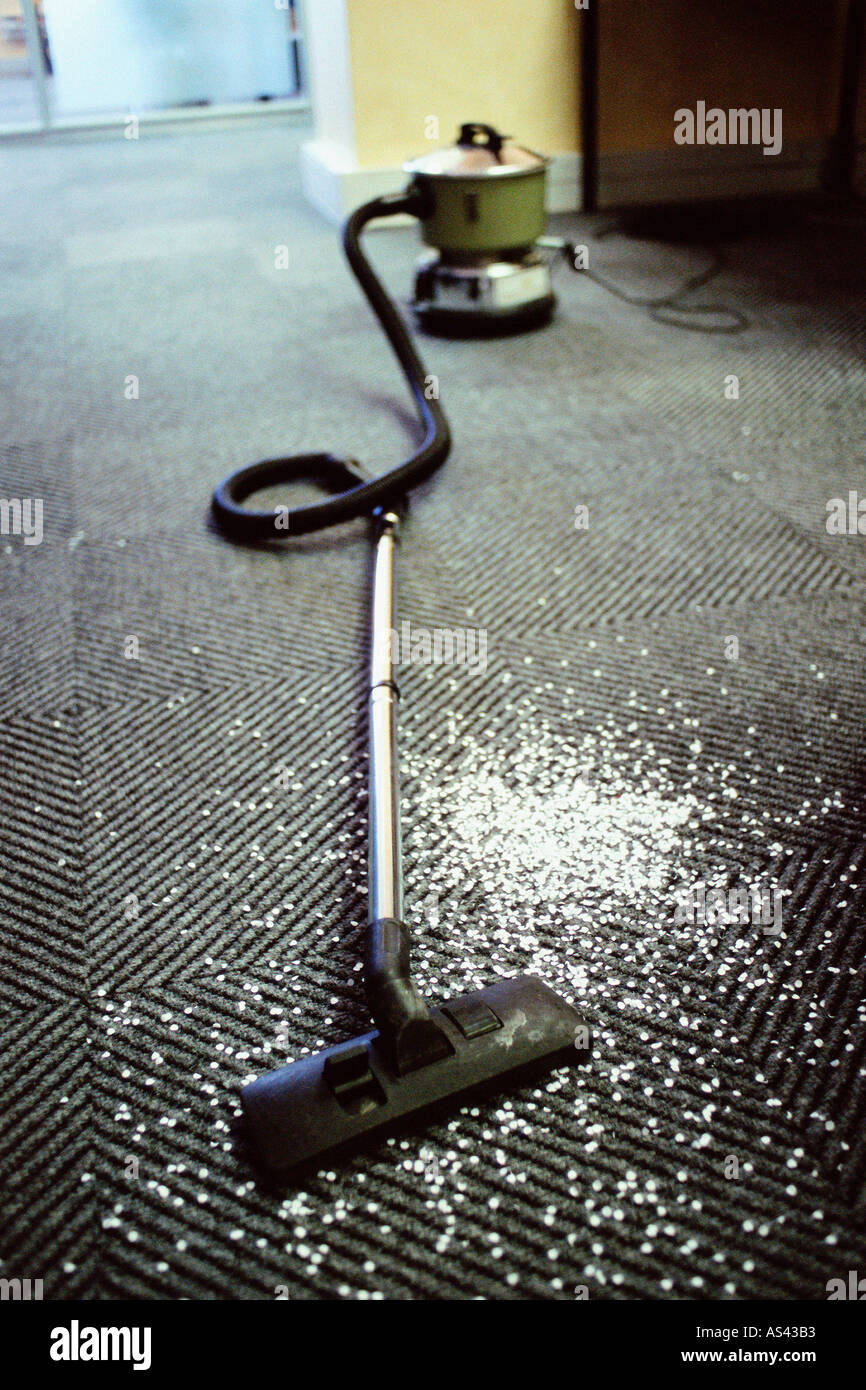 Hoover and messy carpet - Stock Image