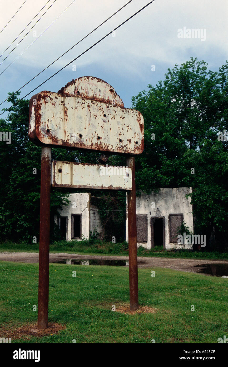 Rusting sign near building - Stock Image