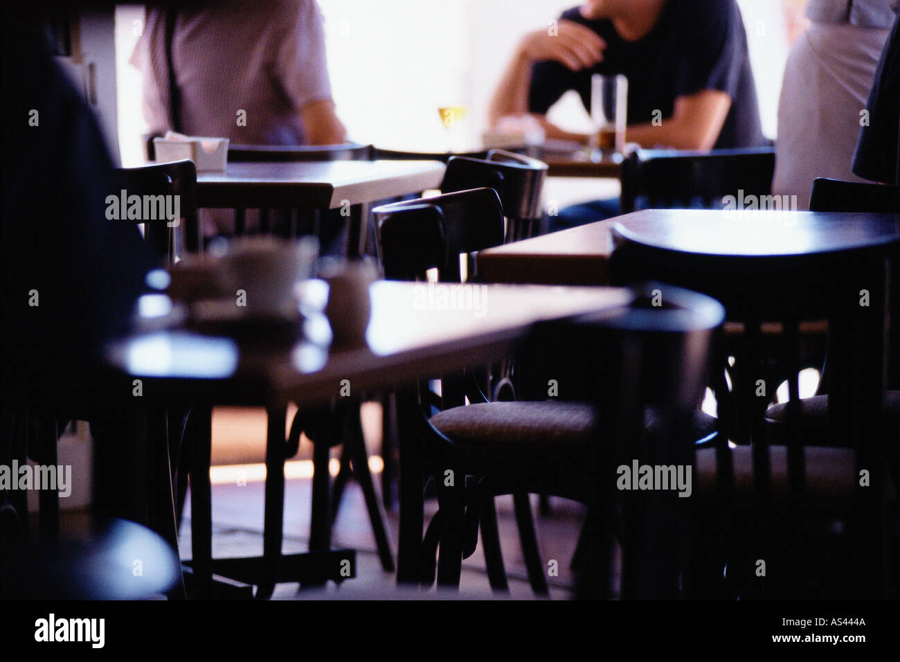 Two men being served in cafe Stock Photo