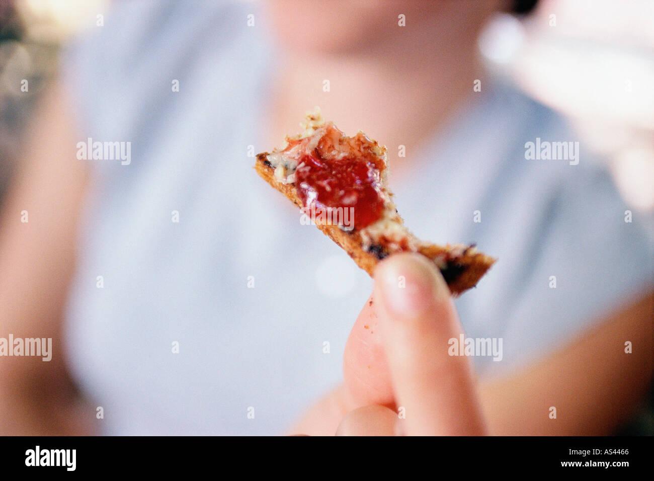 Last bit of jam on toast - Stock Image