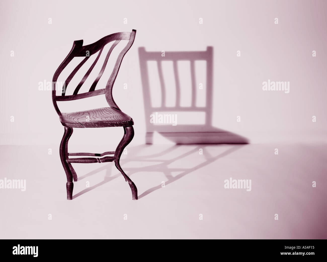 distorted chair with normal shadow - Stock Image