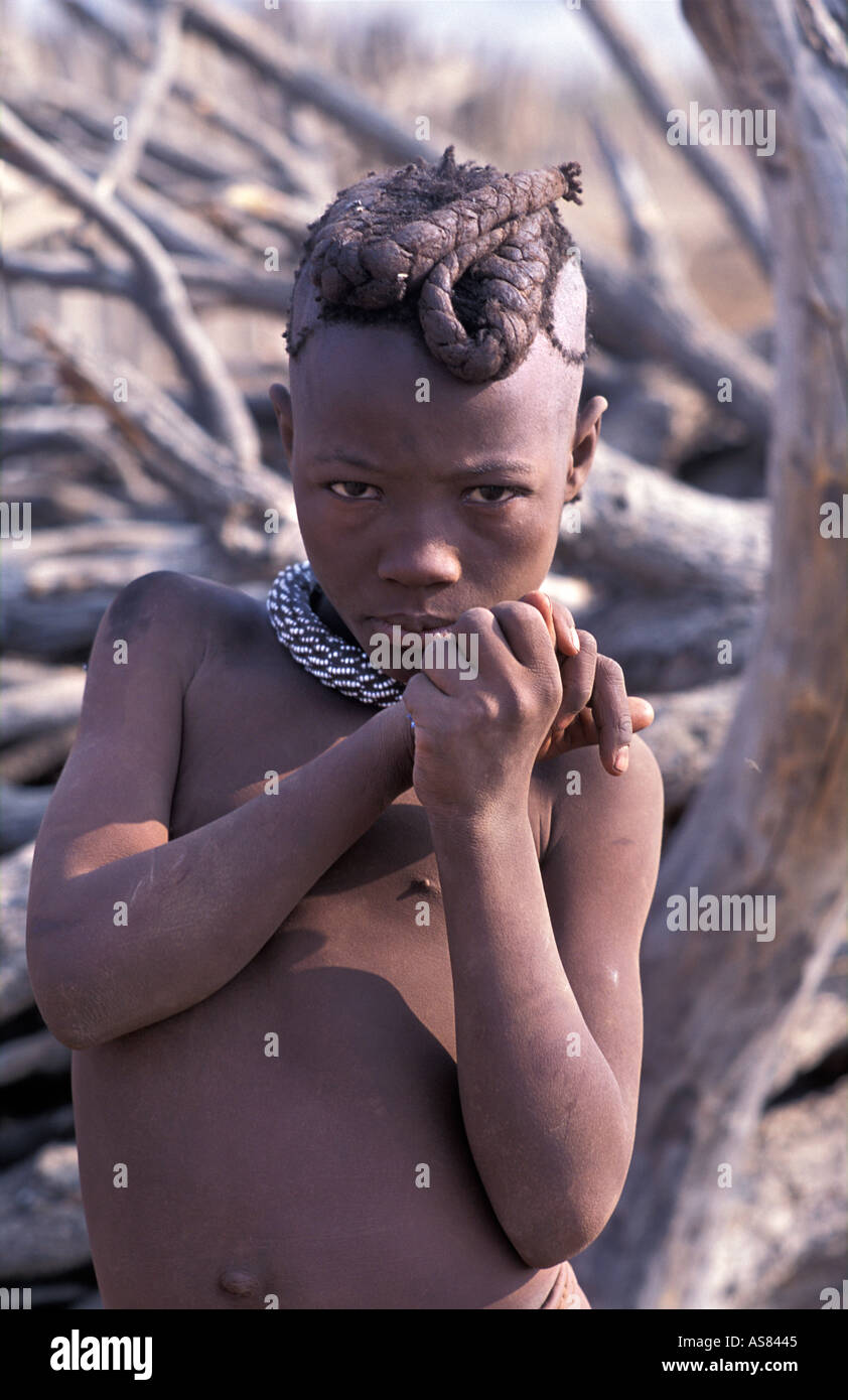 Himba girl photographed in her village Kaokoveld tribal areas North west of Opuwo Namibia Stock Photo