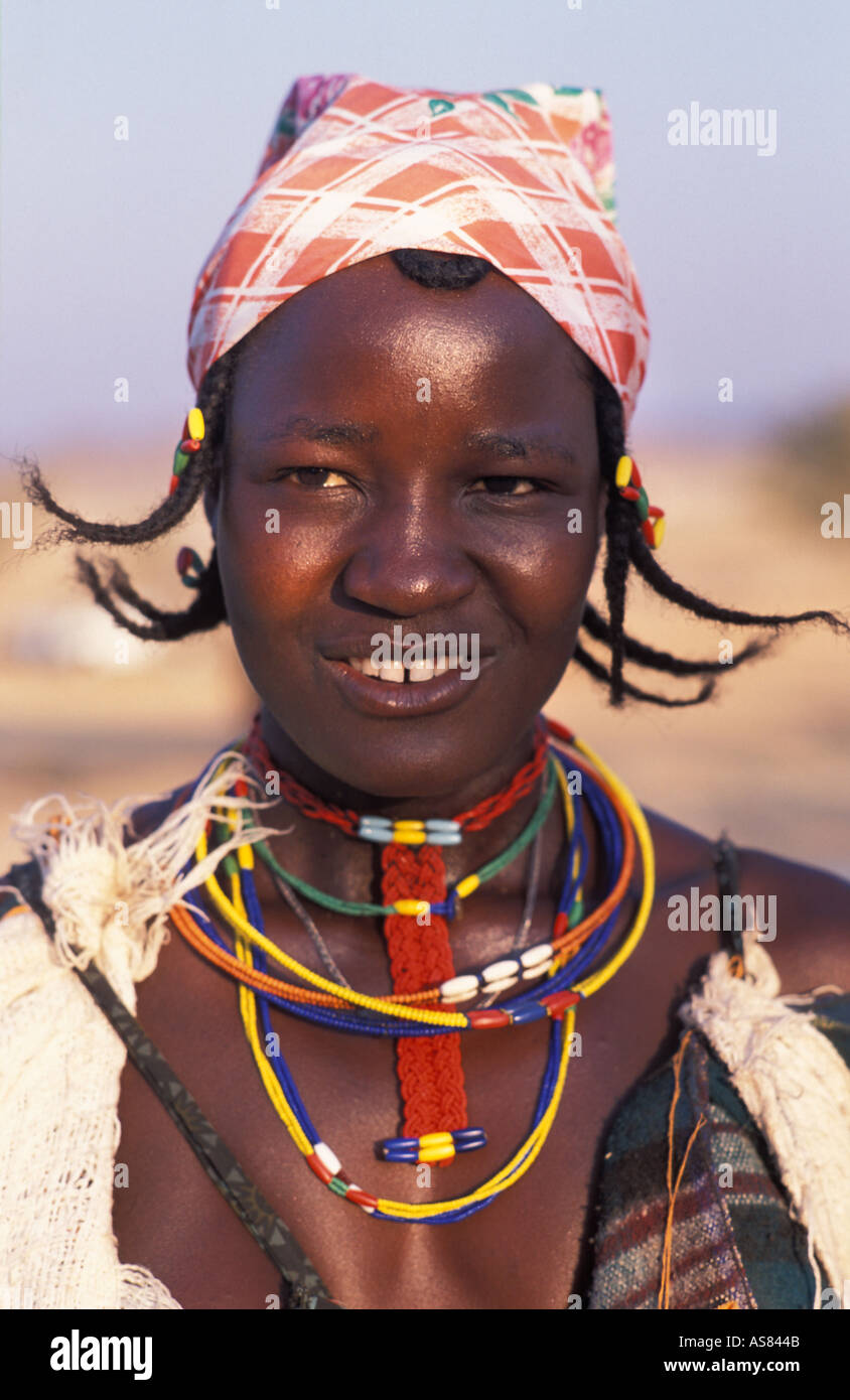 Opuwo Zemba Dhimba woman in tribal costume with adornments Angolan tribe Namibia - Stock Image