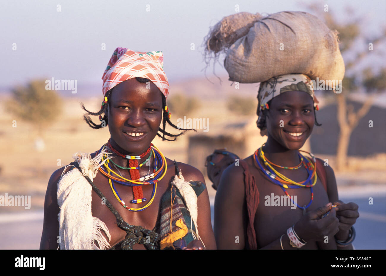 Opuwo Namibia Zemba Dhimba women in tribal costume Angolan tribe - Stock Image