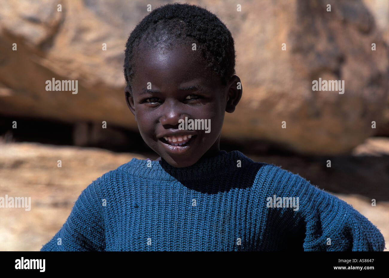 Friendly Damara boy living adjacent to the rock paintings nr Uis - Stock Image