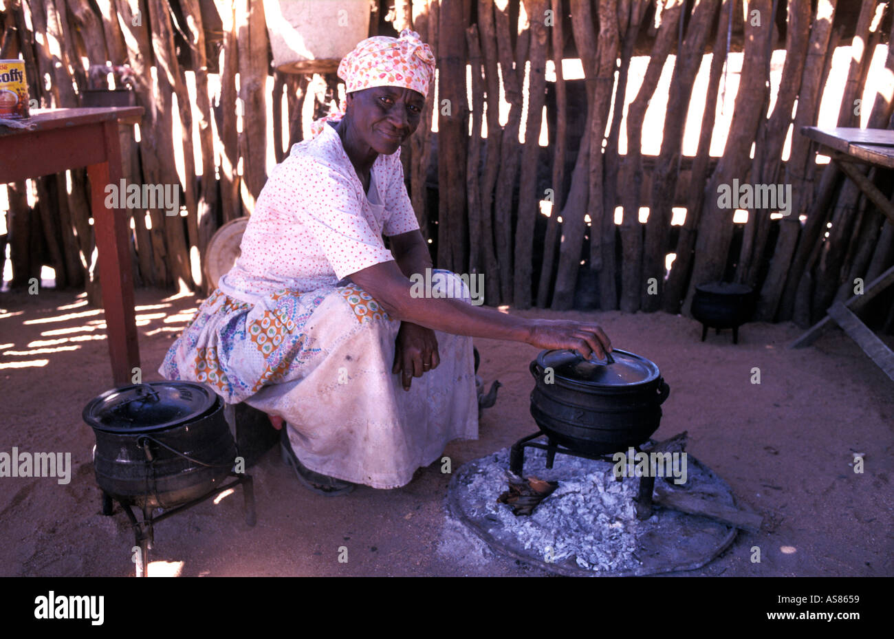 Damara woman inside her kitchen hut Brandberg hills area near Uis Namibia - Stock Image