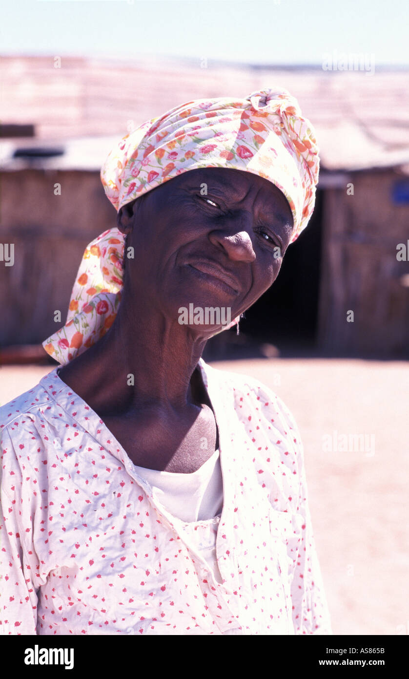 Damara woman outside her home Brandberg hills area near Uis Namibia - Stock Image