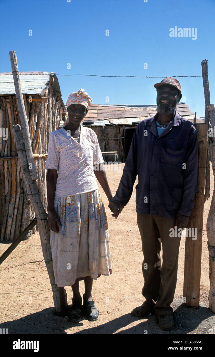 Elderly Damara couple photographed at the entrance to their homestead Near Twelfontein Namibia - Stock Image
