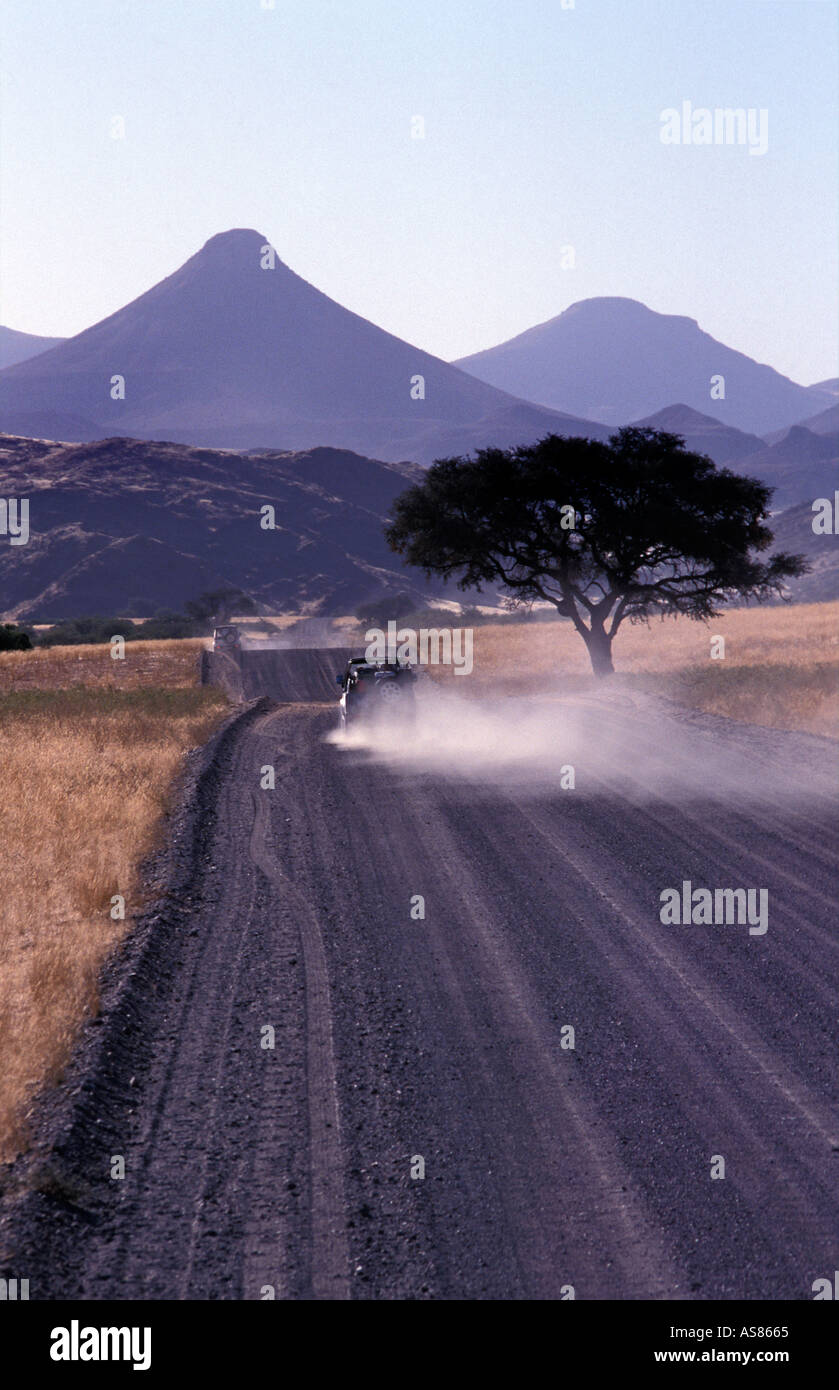 Ancient landscape Palmwag to Sesfontein Extinct volcanoes and tabletop mountains Travelling by 4x4 on gravel roads Namibia - Stock Image