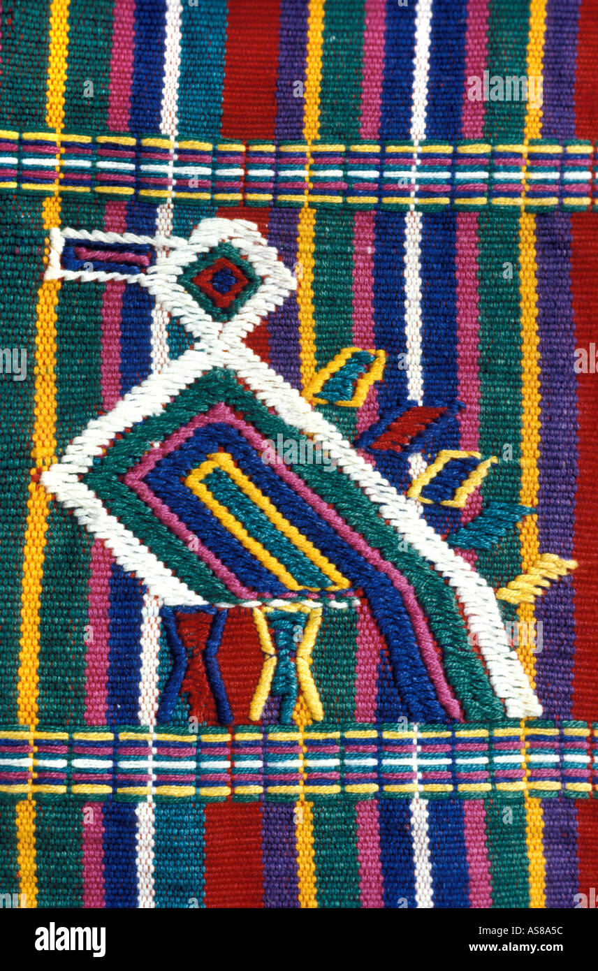 Brocaded bird on handwoven textile Nebaj El Quiche Guatemala The quetzal is a national symbol - Stock Image