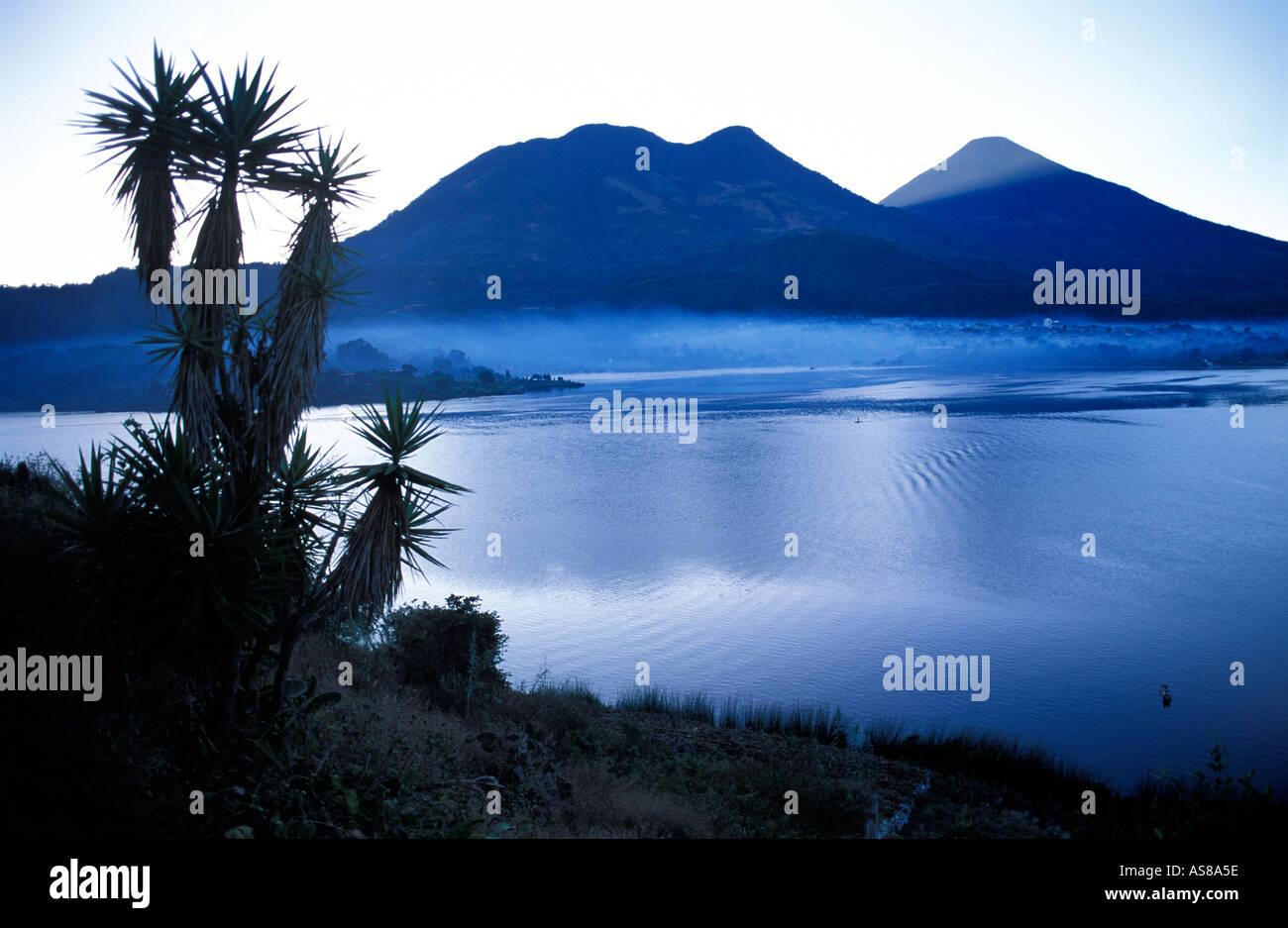 Santiago Atitlan sits beneath the towering peak of Toliman volcano Lake Atitlan at dawn Guatemala - Stock Image