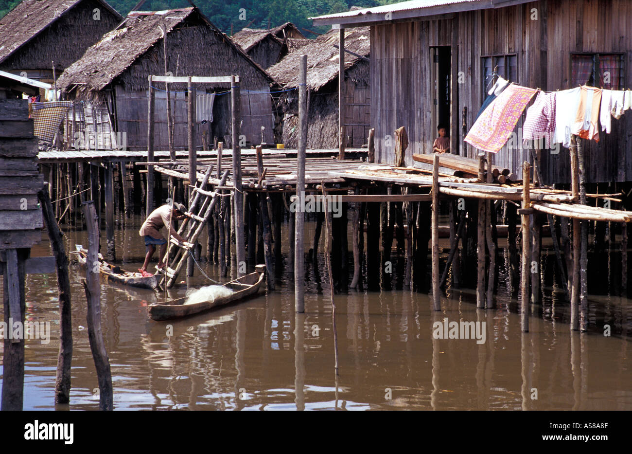 Houses built on stilts and reached by canoe Coastal community nr Kota Kinabalu Sabah Malaysia - Stock Image