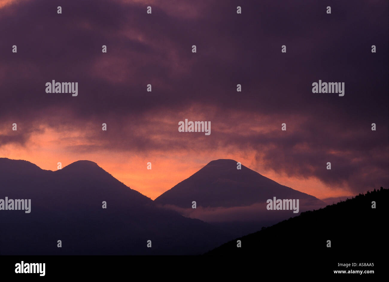View from Santiago Atitlan Lake Atitlan Guatemala Atmospheric silhouette of Atitlan and Toliman volcanoes at sunrise - Stock Image