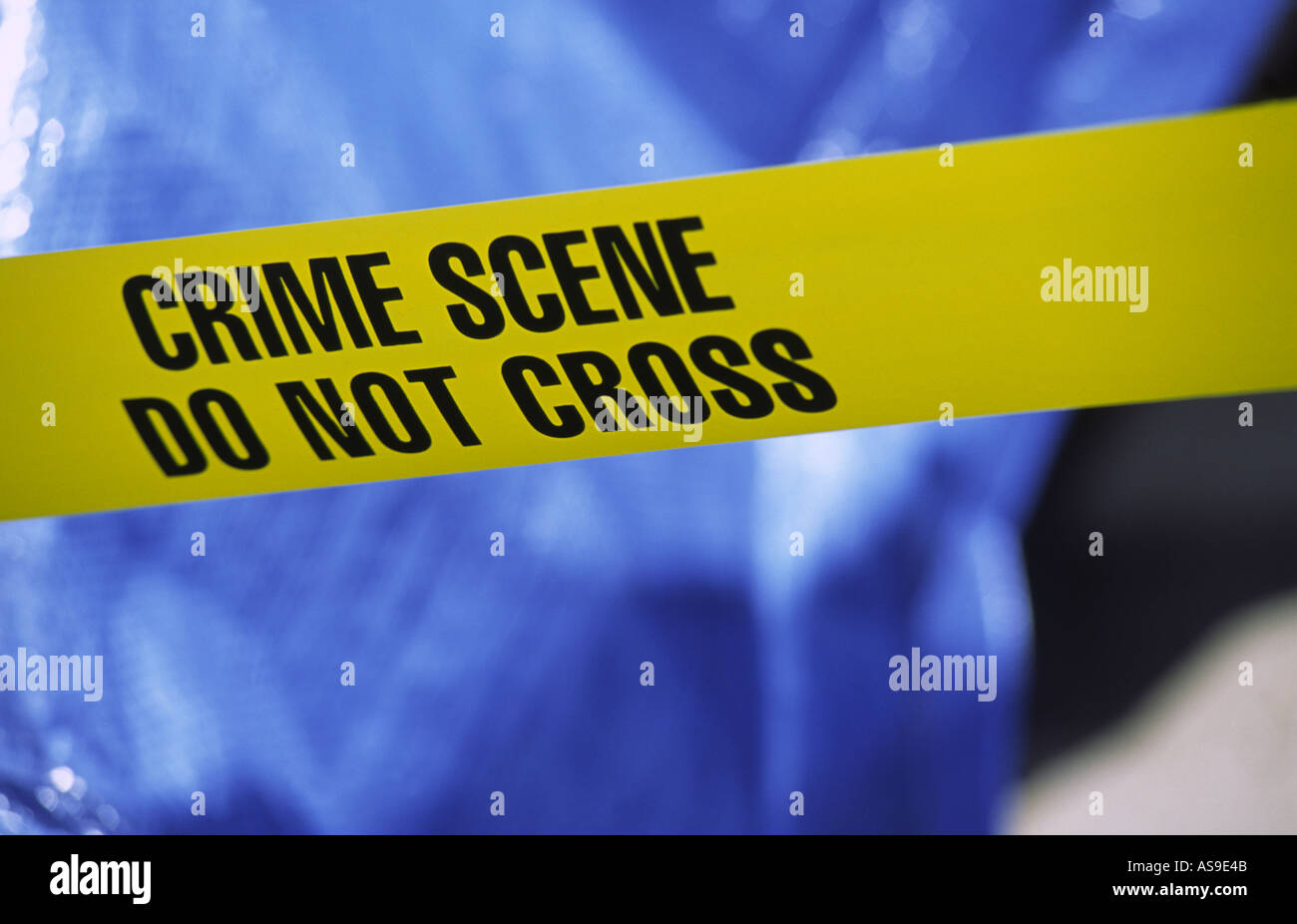 crime scene taped off with yellow police crime scene tape - Stock Image