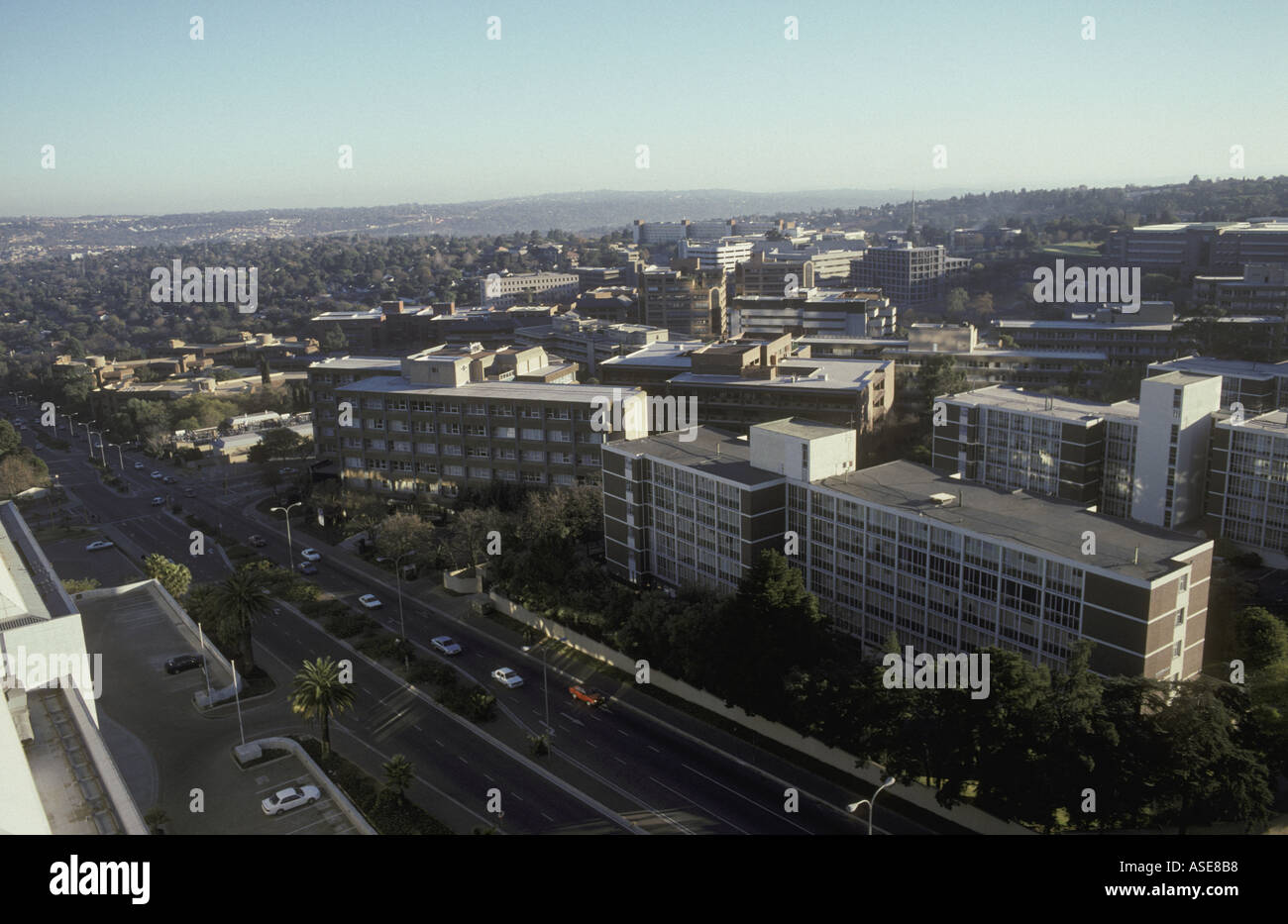 Blocks of flats and a busy dual carriageway road in Sandton a fashionable suburb of Johannesburg South Africa - Stock Image