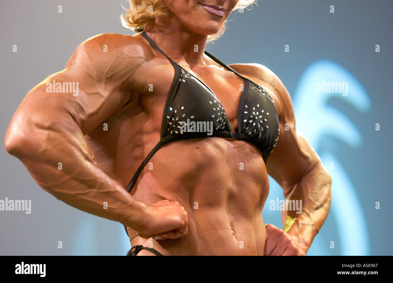 female bodybuilder flexing her muscles Stock Photo