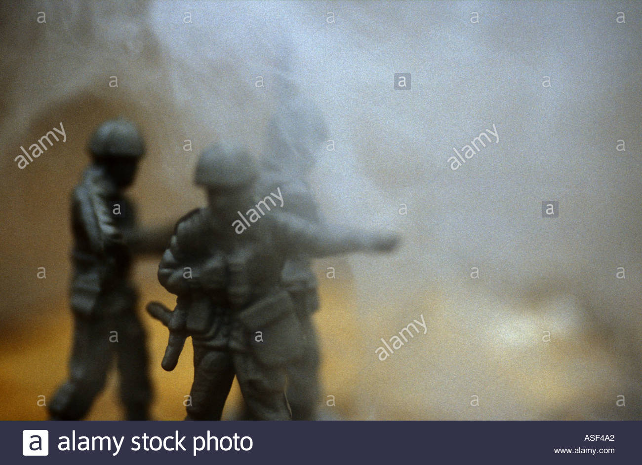 Soldier Giving Orders while others observe - Stock Image