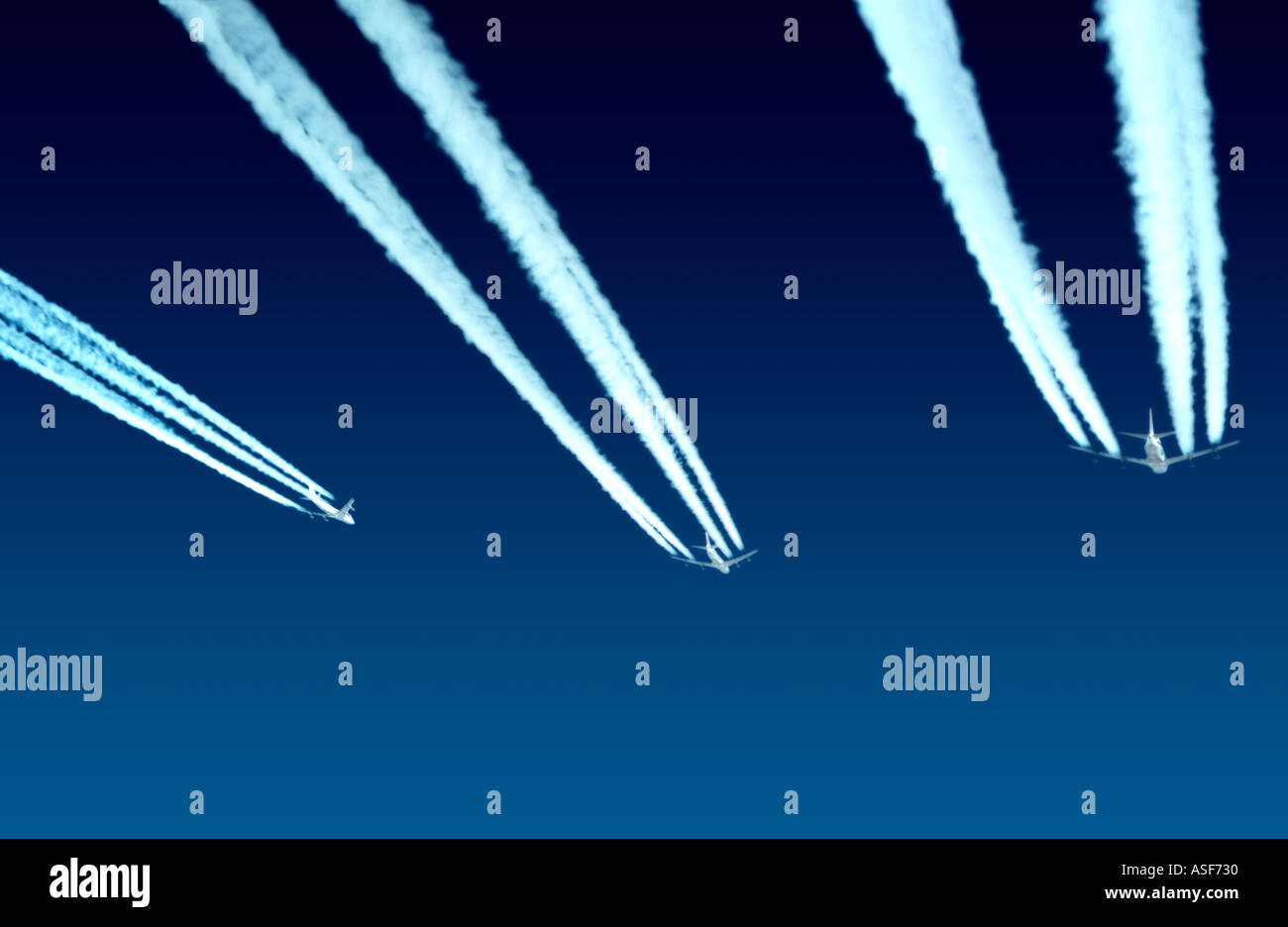 Jumbo jets flying at high altitude - Stock Image