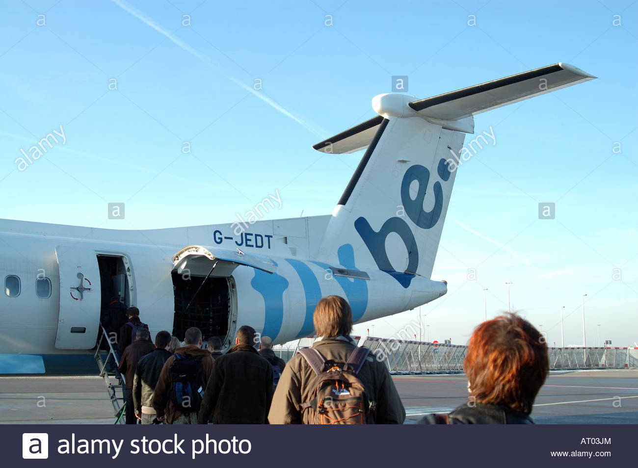 Schihol The Netherlands Passengers boarding a Flybe Dash 8 - Stock Image