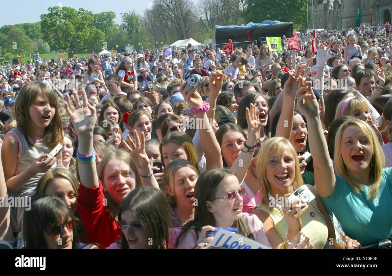 Crowd of teenage girls at pop concert - Stock Image