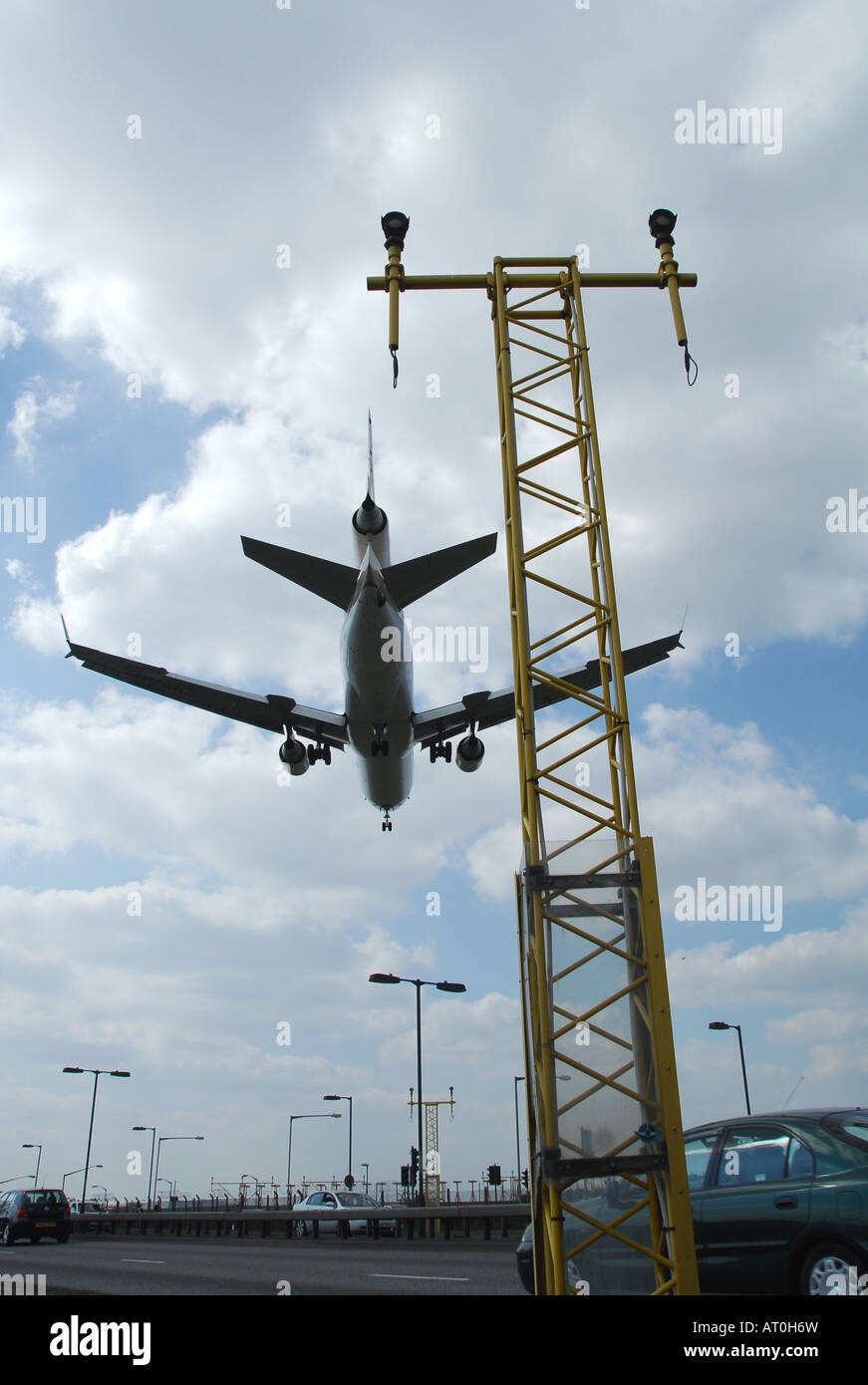 A MD-11 passes over the ILS just before landing at Heathrow airport London - Stock Image