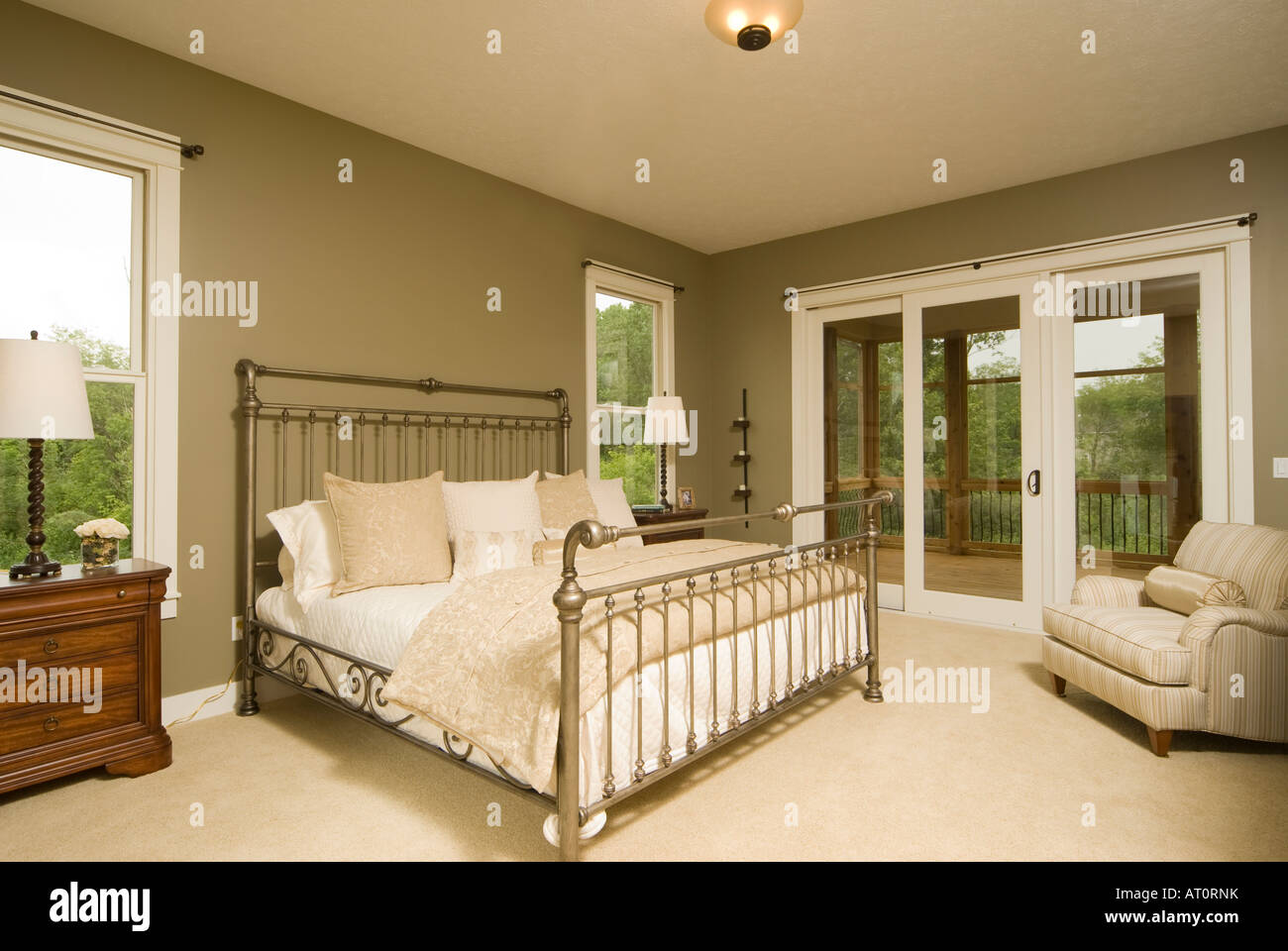 American master bedroom with king size bed and sliders to ...