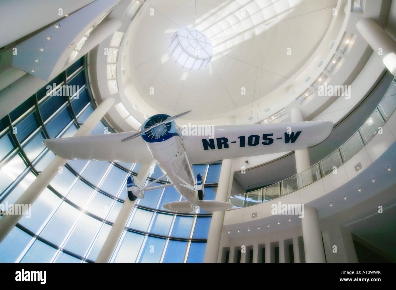 A replica of Oklahoma aviator Wiley Post's Winnie Mae hangs in the atrium of the Oklahoma History Center. - Stock Image