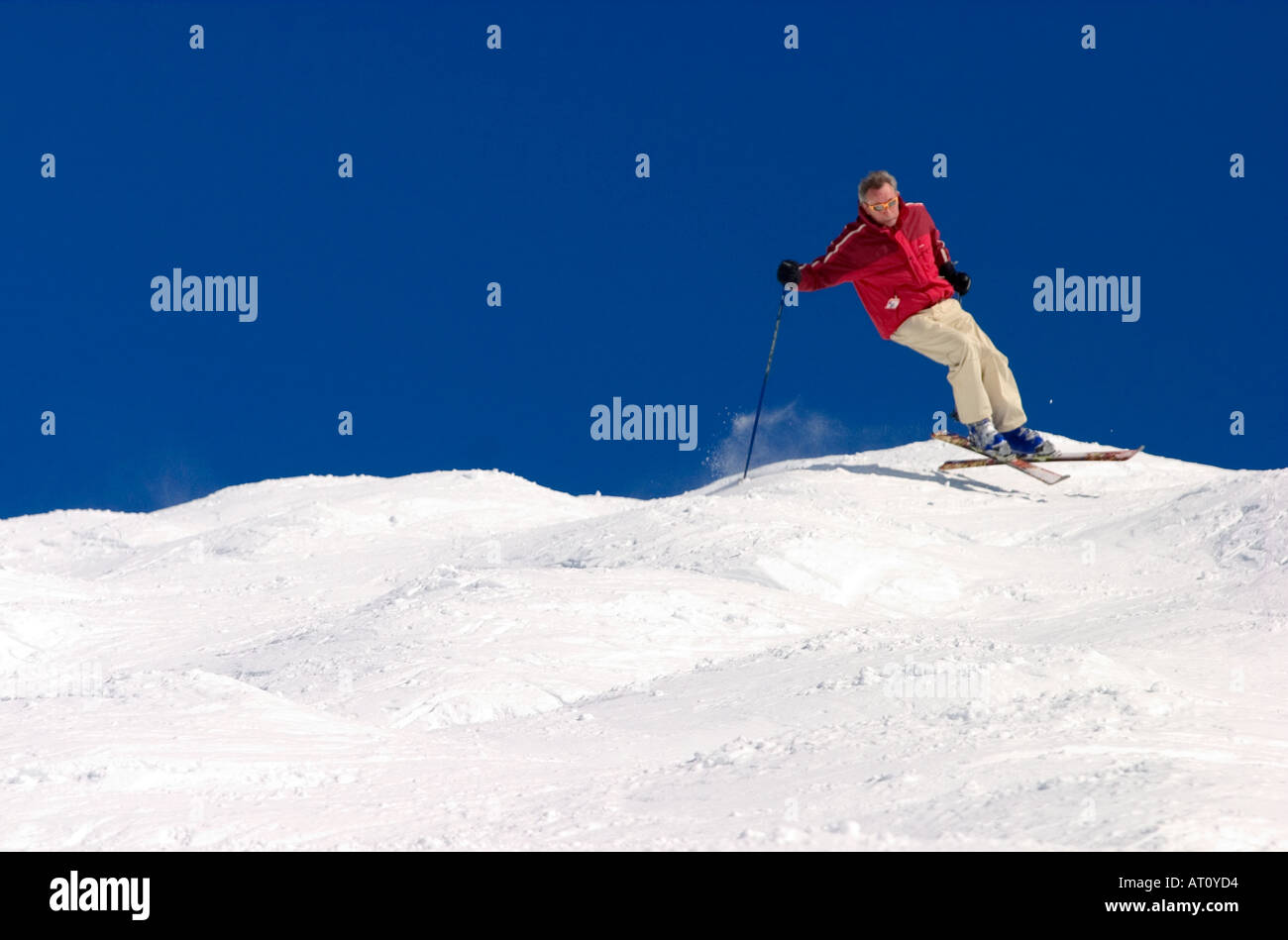 man enjoying the powder snow through on a winter day in grand bornand France - Stock Image