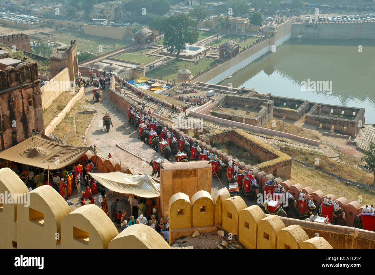 Horizontal Aerial View Of A Procession Working Elephants In Queue At The Entrance To Amber Palace Near Jaipur