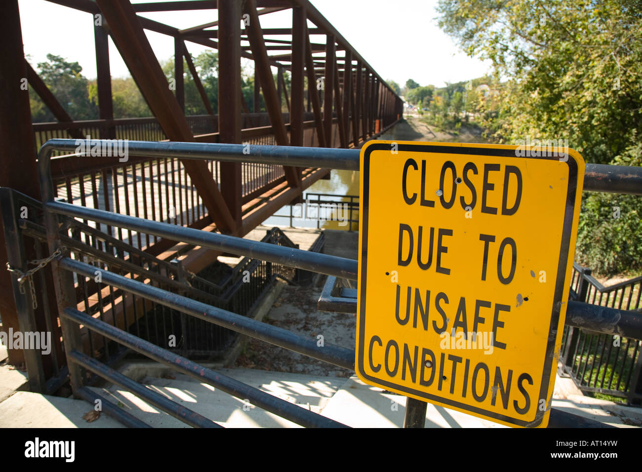 ILLINOIS Batavia Closed due to unsafe conditions sign posted on padlocked fence near pedestrian bridge over Fox - Stock Image