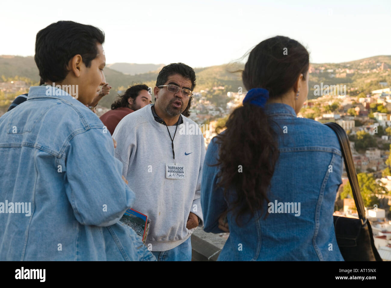 MEXICO Guanajuato Tourist guide with badge talking with group of visitors to Pipila monument scenic overlook of - Stock Image