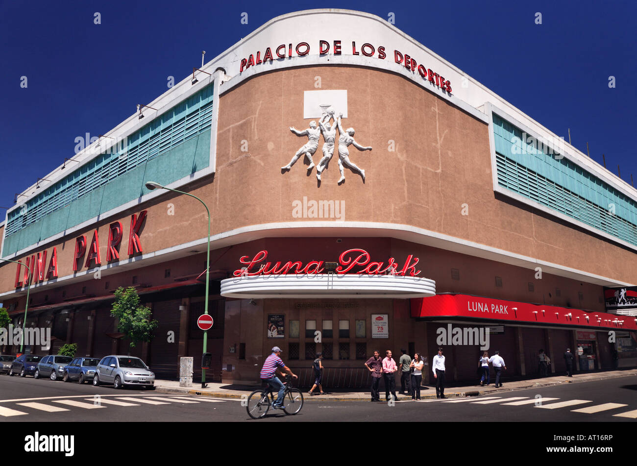 Luna Park Stadium Facade Corner, with people walking and a bicycle passing. Downtown, Buenos Aires, Argentina - Stock Image
