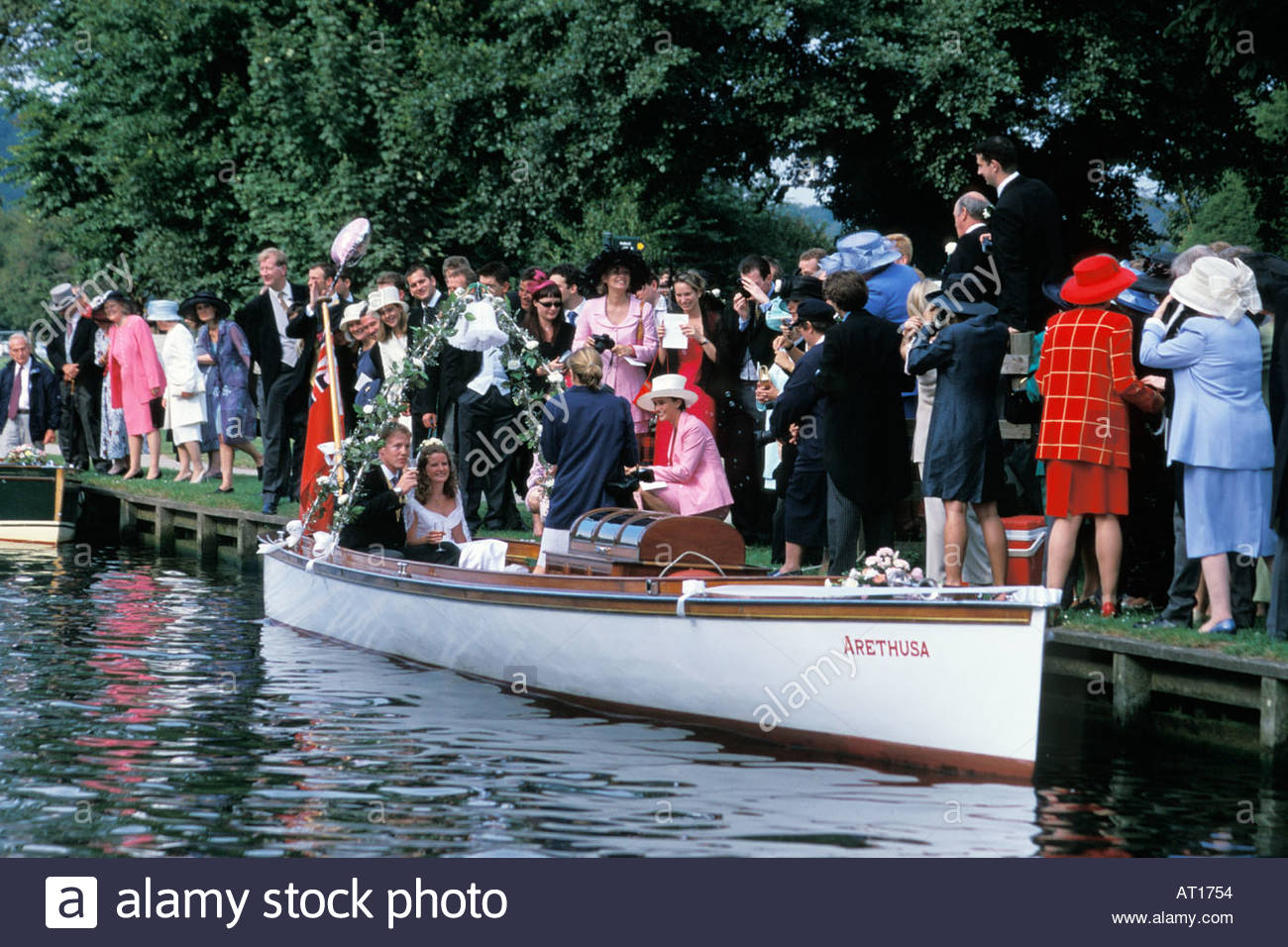 Couple leaving for their wedding reception on a Henley regatta umpirer's launch at Remenham, UK Stock Photo