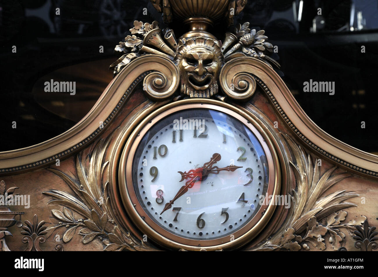 A clock above the front door of the Paramount Theatre Building on Broadway in Manhattan. - Stock Image