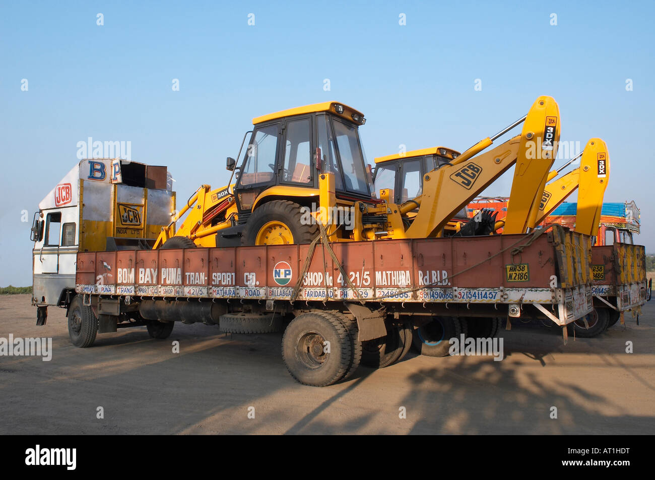 Earth Movers in Truck in morning light Maharashtra, India. - Stock Image
