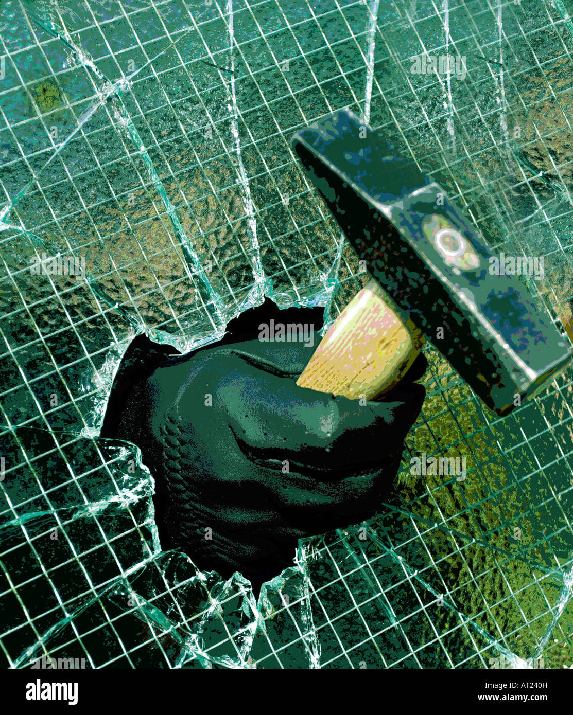 Breaking and entering into a private property by smashing through wire enforced glass pane using a hammer. - Stock Image