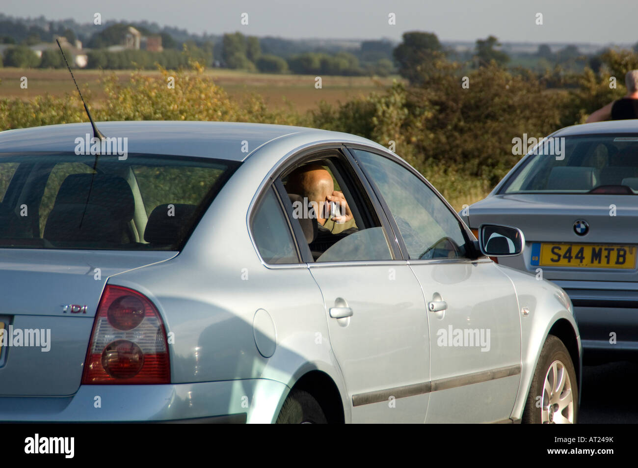 Motorway Sign Delay Stock Photos Images In Car Lights Mobile Phone Being Used A Vehicle Whilst Delayed Traffic Jam On The Uk