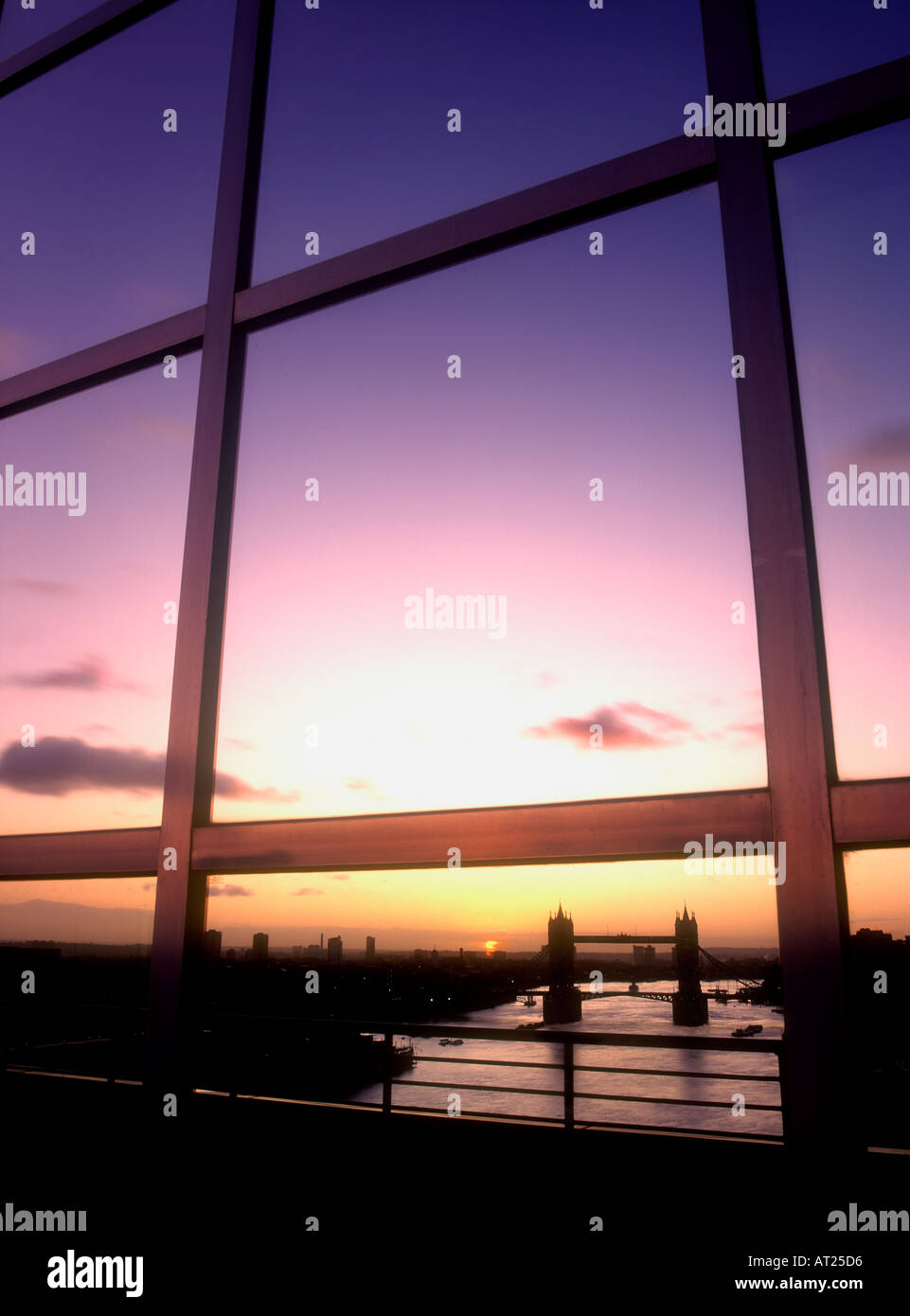 Tower Bridge London reflected in modern city office building window at sunrise London UK - Stock Image
