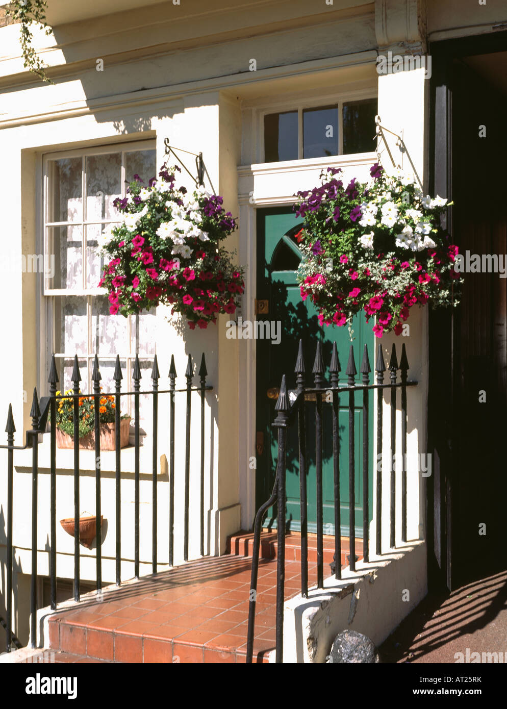 Iron Railings And Pink And Red Petunias In Hanging Baskets On Either