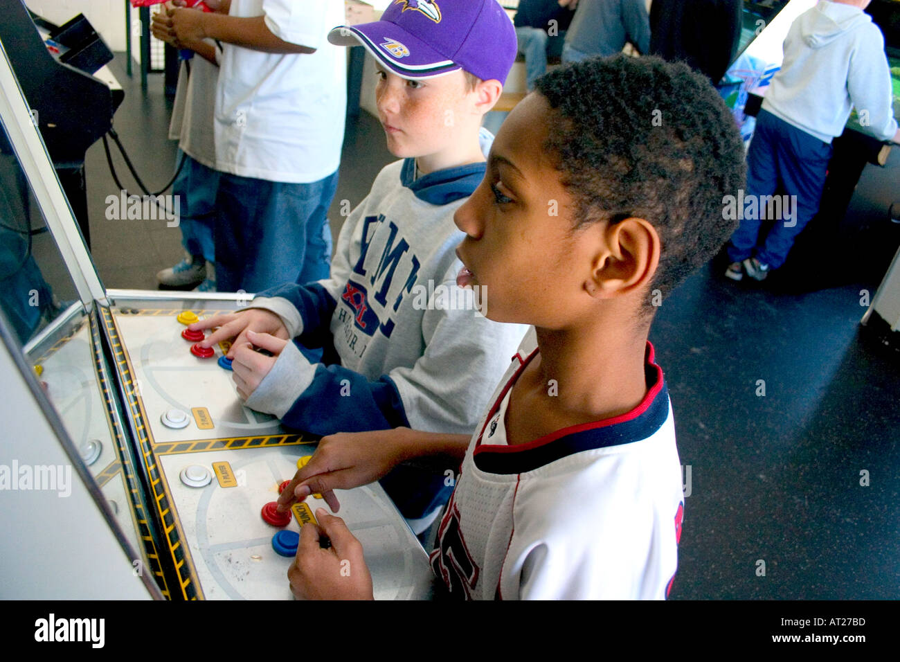 Friends age 10 playing video games developing their eye hand coordination. St Paul Minnesota MN USA - Stock Image